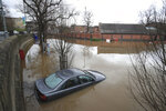 A car submerged in flood water in York, north England, Monday Feb. 17, 2020. Storm Dennis hammered Britain Sunday, bringing a month's worth of rain in just 48 hours to parts of the UK. Rivers across Britain burst their banks and a number of severe flood warnings remained in place as authorities strove to get people to safety and to protect homes and businesses. (Danny Lawson/PA via AP)