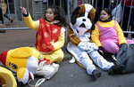 Parade participants rest before they march in the Lunar New Year parade in the Chinatown neighborhood of New York, Sunday, Feb. 9, 2020. (AP Photo/Craig Ruttle)