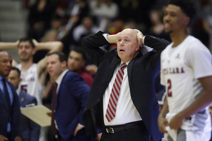 Santa Clara coach Herb Sendek, center, reacts to an official's call during the second half of the team's NCAA college basketball game against Gonzaga in Santa Clara, Calif., Thursday, Jan. 30, 2020. (AP Photo/Jeff Chiu)