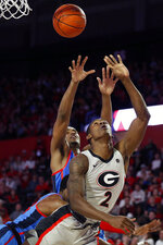 Georgia's Jordan Harris (2) takes a shot passed Mississippi guard/forward Blake Hinson (0) during an NCAA college basketball game in Athens, Ga., Saturday, Jan. 25, 2020. (Joshua L. Jones/Athens Banner-Herald via AP)