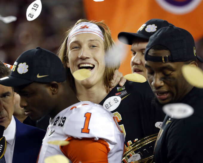Clemson's Trevor Lawrence celebrates after the NCAA college football playoff championship game against Alabama, Monday, Jan. 7, 2019, in Santa Clara, Calif. Clemson beat Alabama 44-16. (AP Photo/Chris Carlson)