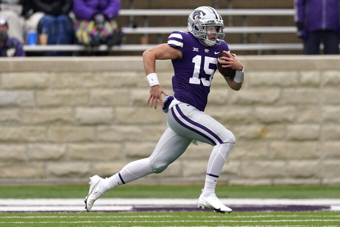 Kansas State quarterback Will Howard runs the ball during the first half of an NCAA football game against Kansas Saturday, Oct. 24, 2020, in Manhattan, Kan. (AP Photo/Charlie Riedel)