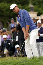 Amateur player, Brandon Wu, hits a chip shot on the second hole during the final round of the U.S. Open Championship golf tournament Sunday, June 16, 2019, in Pebble Beach, Calif. (AP Photo/Carolyn Kaster)