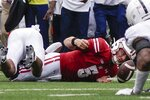 Wisconsin's Graham Mertz fumbles the ball during the second half of an NCAA college football game against Penn State Saturday, Sept. 4, 2021, in Madison, Wis. Penn State won 16-10. (AP Photo/Morry Gash)