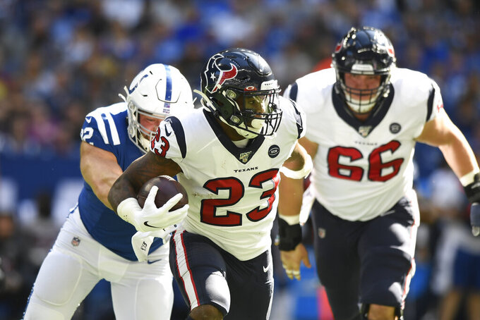 Houston Texans running back Carlos Hyde (23) runs during the first half of an NFL football game against the Indianapolis Colts, Sunday, Oct. 20, 2019, in Indianapolis. (AP Photo/Doug McSchooler)