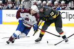 Vegas Golden Knights center Nicolas Roy (10) breaks a stick on Colorado Avalanche center Tyson Jost (17) during the third period in Game 6 of an NHL hockey Stanley Cup second-round playoff series Thursday, June 10, 2021, in Las Vegas. (AP Photo/John Locher)