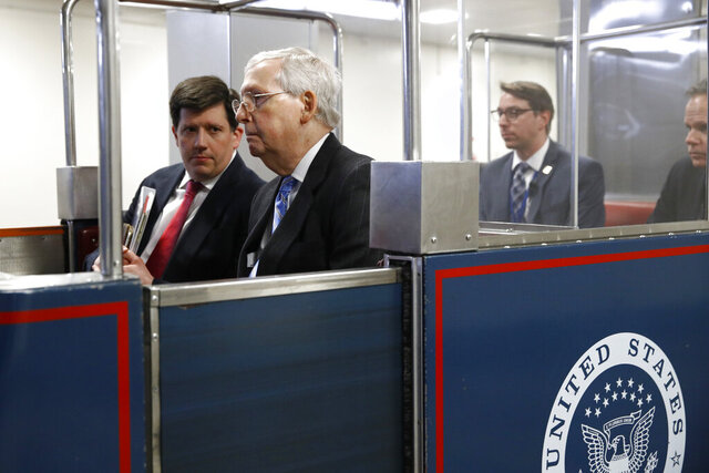 Senate Majority Leader Mitch McConnell of Ky., rides a subway car on Capitol Hill in Washington, Wednesday, March 18, 2020, before a vote on a coronavirus response bill. (AP Photo/Patrick Semansky)