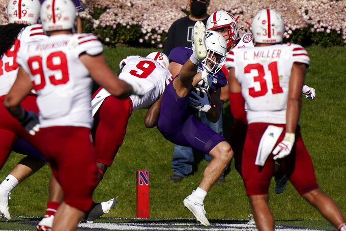 Northwestern tight end John Raine catches a touchdown pass during the second half of an NCAA college football game against Nebraska in Evanston, Ill., Saturday, Nov. 7, 2020. Northwestern won 21-13. (AP Photo/Nam Y. Huh)