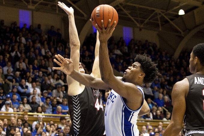 Duke's Vernon Carey Jr., right, attempts a shot as Brown's Matt DeWolf (44) defends during the second half of an NCAA college basketball game in Durham, N.C., Saturday, Dec. 28, 2019. (AP Photo/Ben McKeown)