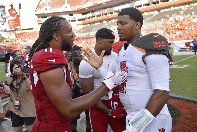 Arizona Cardinals wide receiver Larry Fitzgerald (11) shakes hands with Tampa Bay Buccaneers quarterback Jameis Winston (3) after an NFL football game Sunday, Nov. 10, 2019, in Tampa, Fla. (AP Photo/Jason Behnken)