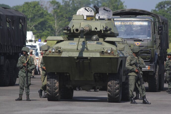 Soldiers take part in a military exercise at the Garcia Hevia airport in La Fria in the State of Tachira, Venezuela, Tuesday, Sept 10, 2019. Venezuela's President Nicolás Maduro launched extended military exercises along the border with Colombia, drawing Washington's attention amid rising friction between the South American neighbors. (AP Photo/Rafael Urdaneta Rojas)
