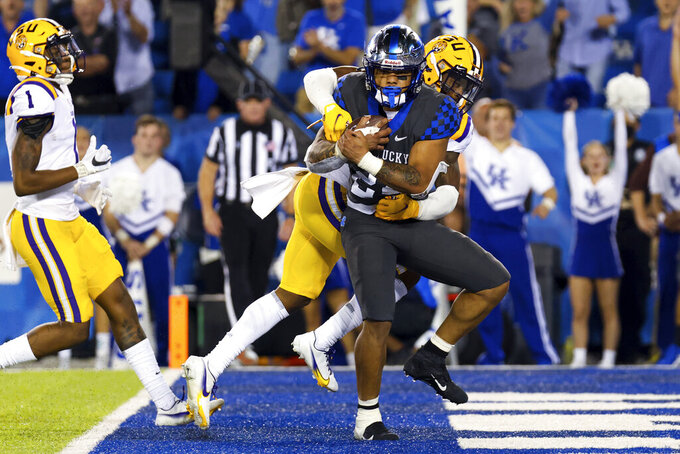 Kentucky running back Chris Rodriguez Jr. (24) runs the ball into the end zone for a touchdown during the second half against LSU in an NCAA college football game in Lexington, Ky., Saturday, Oct. 9, 2021. (AP Photo/Michael Clubb)