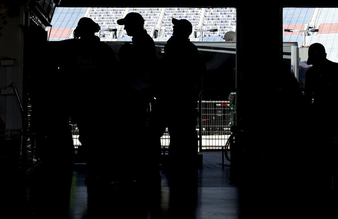 Crew members for Denny Hamlin check monitors during a practice for the NASCAR Sprint Cup Series auto race at Chicagoland Speedway in Joliet, Ill., Saturday, June 29, 2018. (AP Photo/Nam Y. Huh)