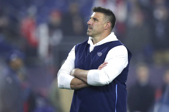FILE - In this Jan. 4, 2020, file photo, Tennessee Titans head coach Mike Vrabel watches his team warm up before an NFL wild-card playoff football game against the New England Patriots, in Foxborough, Mass. It's taken first-time head coach Mike Vrabel two seasons, but the hands' on former linebacker with three Super Bowl rings himself has them a win away from the franchise's second Super Bowl berth. (AP Photo/Charles Krupa, File)
