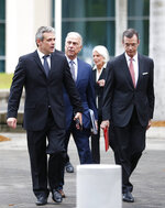 MickaelBehn, left, and JavierGarcia-Bengochea, right, walk out of federal court with attorney Bob Martinez, center, after filing lawsuits against Carnival Cruise Line, which has been using their former properties in Cuba, Thursday, May 2, 2019, in Miami. Behn and Garcia-Bengochea, are the heirs of families that owned ports in Havana and Santiago de Cuba now being used to dock cruise ships that began traveling to Cuba in 2016 under President Barack Obama's detente with the island. (AP Photo/Wilfredo Lee)