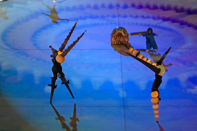 Dancers perform during the opening ceremony for the 2020 Paralympics at the National Stadium in Tokyo, Tuesday, Aug. 24, 2021. (AP Photo/Eugene Hoshiko)