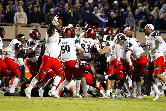 Cincinnati celebrates following a last-second field goal against East Carolina following an NCAA college football game in Greenville, N.C., Saturday, Nov. 2, 2019. (AP Photo/Karl B DeBlaker)