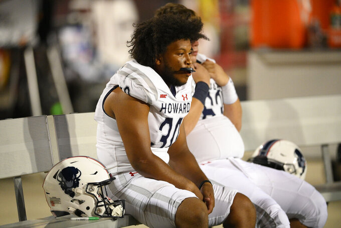 Howard punter Dylan West looks on from the bench during the second half of an NCAA college football game against Maryland, Saturday, Sept. 11, 2021, in College Park, Md. (AP Photo/Nick Wass)