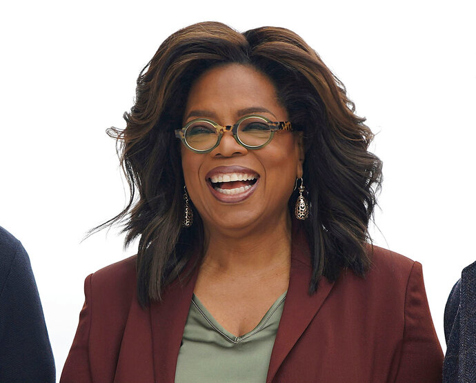 FILE - This March 25, 2019 file photo shows Oprah Winfrey during an event to announce new Apple products in Cupertino, Calif. Winfrey says she's playing it safe when it comes to the rapidly spreading coronavirus. The 66-year-old entertainment icon said that she has been quarantining and practicing social distancing at her home. Winfrey has been busy working despite being stuck at home. She interviewed actor Idris Elba, who tested positive for the coronavirus, through FaceTime for an episode of