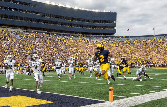 Michigan running back Blake Corum (2) leaps into the end zone for a touchdown in the first quarter of an NCAA college football game against Western Michigan in Ann Arbor, Mich., Saturday, Sept. 4, 2021. (AP Photo/Tony Ding)