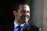 Lebanese Prime Minister Saad Hariri arrives in the garden of the Elysee Palace to meet French President Emmanuel Macron, Friday, Sept. 20, 2019 in Paris. (AP Photo/Francois Mori)