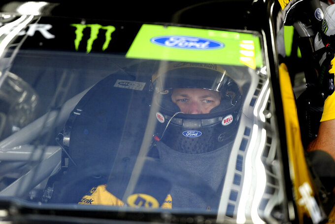 Brad Keselowski is seen in his car during practice for Sunday's NASCAR Cup Series auto race at Charlotte Motor Speedway in Concord, N.C., Saturday, Sept. 28, 2019. (AP Photo/Mike McCarn)