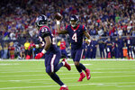 Houston Texans quarterback Deshaun Watson (4) throws a touchdown pass to running back Carlos Hyde (23) during the second half of an NFL wild-card playoff football game against the Buffalo Bills Saturday, Jan. 4, 2020, in Houston. (AP Photo/Michael Wyke)