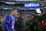 New York Giants quarterback Eli Manning (10) talks with the media after an NFL football game against the Miami Dolphins, Sunday, Dec. 15, 2019, in East Rutherford, N.J. The Giants won 36-20. (AP Photo/Seth Wenig)