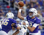 James Madison quarterback Cole Johnson (12) throws a pass during the first half against Morehead State in an NCAA college football game in Harrisonburg, Va., Saturday, Sept. 4, 2021. (Daniel Lin/Daily News-Record via AP)