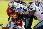 Carolina Panthers cornerback Corn Elder, center, and teammates tackle Kansas City Chiefs running back Clyde Edwards-Helaire during the first half of an NFL football game in Kansas City, Mo., Sunday, Nov. 8, 2020. (AP Photo/Orlin Wagner)