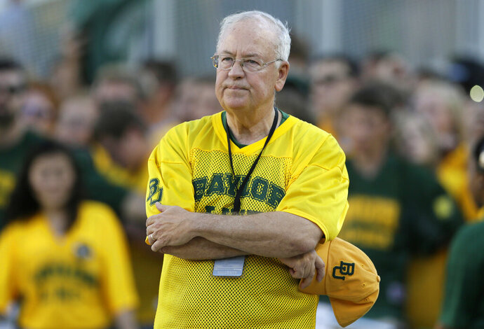 FILE - In the Sept. 12, 2015, file photo, Baylor President Ken Starr waits to run onto the field before an NCAA college football game in Waco, Texas.  Starr told the Waco Tribune-Herald that he hosted a fundraiser at his home for the legal defense fund of Shawn Oakman, a former star defensive end for the Bears who was acquitted of rape last month.. Starr was fired as Baylor's president in 2016, after an outside investigation determined there was a