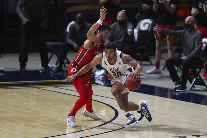 California forward Matt Bradley drives to the basket against Utah forward Timmy Allen during the first half of an NCAA college basketball game in Berkeley, Calif., Thursday, Feb. 11, 2021. (AP Photo/Jed Jacobsohn)