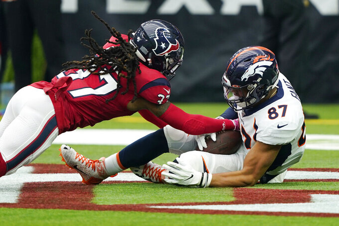Denver Broncos tight end Noah Fant (87) pulls us a catch for a touchdown in front of Houston Texans strong safety Jahleel Addae (37) during the first half of an NFL football game Sunday, Dec. 8, 2019, in Houston. (AP Photo/David J. Phillip)