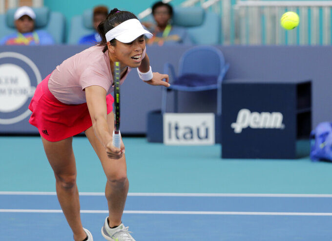 Hsieh Su-Wei, of Taiwan, returns to Naomi Osaka, of Japan, during the Miami Open tennis tournament, Saturday, March 23, 2019, in Miami Gardens, Fla. (AP Photo/Lynne Sladky)
