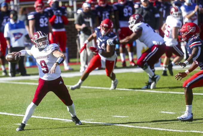 Massachusetts quarterback Garrett Dzuro (9) looks to make a pass during the first half of a NCAA college football game against Liberty on Friday, Nov. 27, 2020, at Williams Stadium in Lynchburg, Va. (AP Photo/Shaban Athuman)