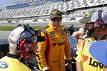 Michael McDowell, center, talks with crew members on pit road during NASCAR auto race qualifying at Daytona International Speedway, Sunday, Feb. 9, 2020, in Daytona Beach, Fla. (AP Photo/John Raoux)