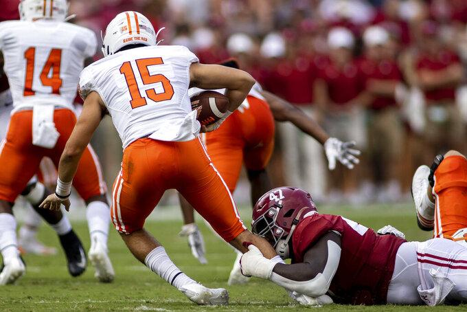 Alabama defensive lineman Byron Young (47) sacks Mercer quarterback Carter Peevy (15) during the first half of an NCAA college football game, Saturday, Sept. 11, 2021, in Tuscaloosa, Ala. (AP Photo/Vasha Hunt)