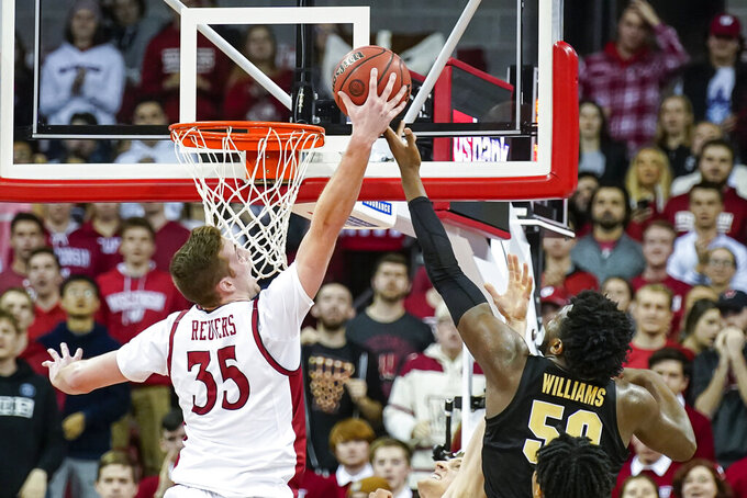 Wisconsin's Nate Reuvers (35) blocks Purdue's Trevion Williams (50) during the second half of an NCAA college basketball game Tuesday, Feb. 18, 2020, in Madison, Wis. Wisconsin won 69-65. (AP Photo/Andy Manis)