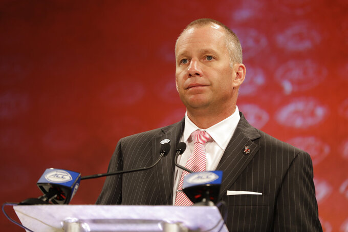 File-This July 19, 2018, file photo shows North Carolina State head coach Dave Doeren answering a question during a news conference at the NCAA Atlantic Coast Conference college football media day in Charlotte, N.C. Doeren's Wolfpack earned the program's second nine-win season in the past 15 years in 2017. (AP Photo/Chuck Burton, File)