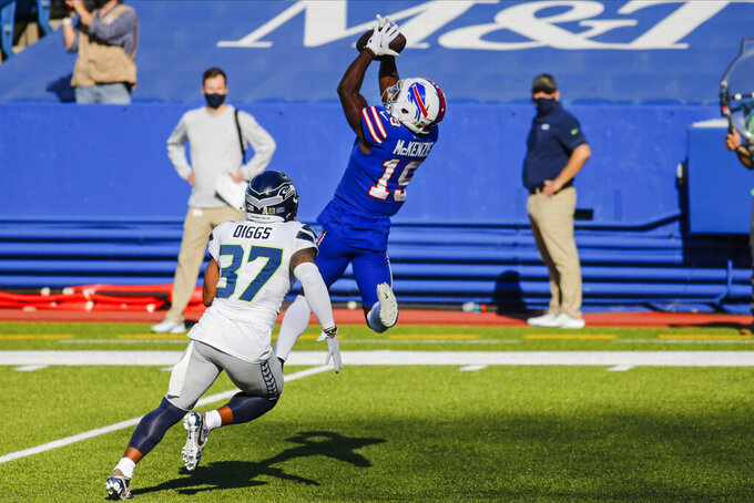 Buffalo Bills wide receiver Isaiah McKenzie (19) catches a pass in front of Seattle Seahawks' Quandre Diggs (37) during the first half of an NFL football game Sunday, Nov. 8, 2020, in Orchard Park, N.Y. McKenzie scored a touchdown on the play. (AP Photo/Jeffrey T. Barnes)