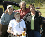 In this Sept. 29, 2009 photo provided by Betsy McNair, Robert McNair, center, poses with his children from left to right, Paul, Mark, and Betsy at Bulls Landing on Mockhorn Bay outside of Townsend, on the Eastern Shore of Virginia. Robert McNair was 83 when he died at his home in Belle Haven, Virginia, in 2009, six weeks after learning he had lung cancer. Betsy, who besides her father, helped care for her brother Paul who died of Lou Gehrig's disease in his 50s, and her mother, who died at age 92 in a nursing home after a long decline in health, is proud of the ending she helped give her father. (Courtesy of Betsy McNair via AP)