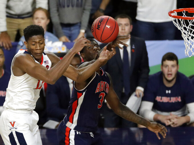 Virginia's De'Andre Hunter (12) and Auburn's Danjel Purifoy (3) battle for a rebound during the second half in the semifinals of the Final Four NCAA college basketball tournament, Saturday, April 6, 2019, in Minneapolis. (AP Photo/Matt York)