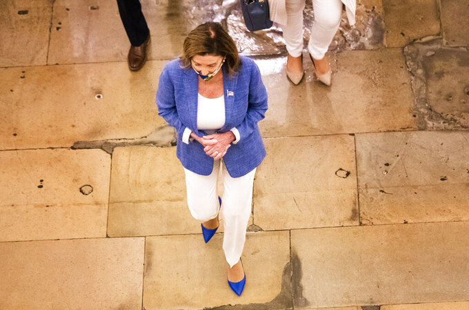 House Speaker Nancy Pelosi walks towards her office at the Capitol to resume talks with White House chief of staff Mark Meadows and Treasury Secretary Steven Mnuchin on a COVID-19 relief bill, Saturday, Aug. 1, 2020, in Washington. (AP Photo/Manuel Balce Ceneta)