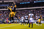 Pittsburgh Steelers wide receiver Anthony Johnson, second left, celebrate a touchdown with Isaiah McKoy during the second half of a preseason NFL football game Thursday, Aug. 12, 2021, in Philadelphia. (AP Photo/Matt Slocum)