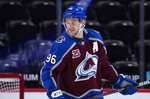 Colorado Avalanche right wing Mikko Rantanen looks back during the third period of the team's NHL hockey game against the Los Angeles Kings on Thursday, May 13, 2021, in Denver. (AP Photo/Jack Dempsey)