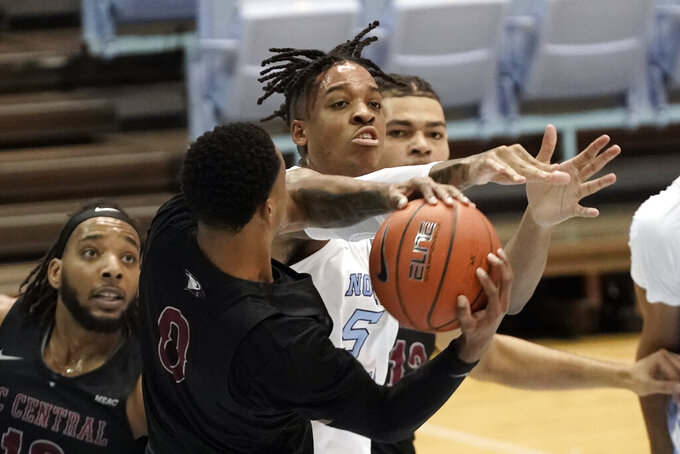North Carolina forward Armando Bacot (5) and North Carolina Central guard Jamir Moultrie (0) struggle for possession of a rebound during the first half of an NCAA college basketball game in Chapel Hill, N.C., Saturday, Dec. 12, 2020. (AP Photo/Gerry Broome)