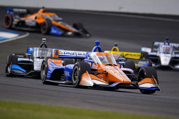 Scott Dixon, of New Zealand, drives through a turn during an IndyCar auto race at Indianapolis Motor Speedway in Indianapolis, Saturday, Oct. 3, 2020. (AP Photo/Michael Conroy)