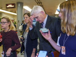 Sen. Bill Cassidy, R-La., is met by reporters as he walks to the chamber for a vote, at the Capitol in Washington, Thursday, June 10, 2021. Sen. Cassidy is working with a bipartisan group of 10 senators negotiating an infrastructure deal with President Joe Biden. (AP Photo/J. Scott Applewhite)