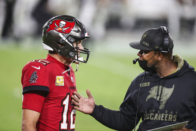 Tampa Bay Buccaneers quarterback Tom Brady (12) talks with offensive coordinator Byron Leftwich after Brady threw another interception during an NFL game against the New Orleans Saints, Sunday, Nov. 8, 2020 in Tampa, Fla. The Saints defeated the Buccaneers 38-3. (Margaret Bowles via AP)