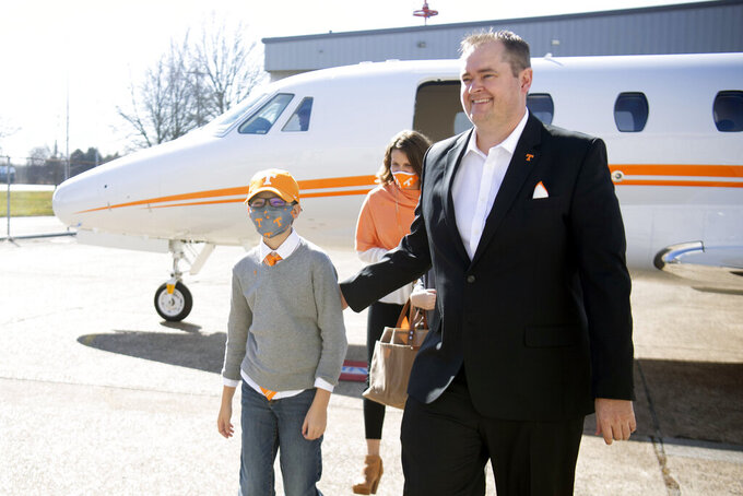 New Tennessee NCAA college football head coach Josh Heupel and his family arrive in Knoxville, Tenn., Wednesday, Jan. 27, 2021. New Tennessee athletic director Danny White announced Wednesday that he has hired Heupel as Tennessee's 27th head coach overall. (Saul Young/Knoxville News Sentinel via AP)